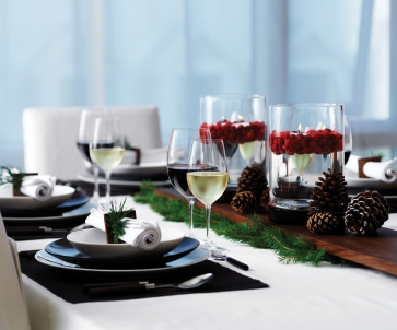 Holiday table with cranberry and floating candle centrepiece.