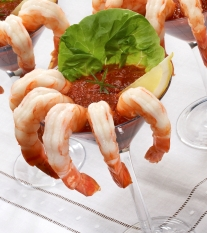 Shrimp in Martini glass with cocktail sauce.