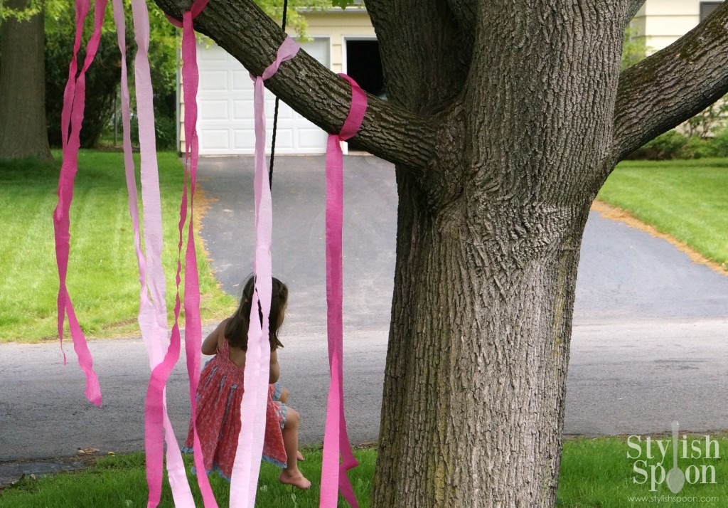 pink princess party tree swing with pink streamers