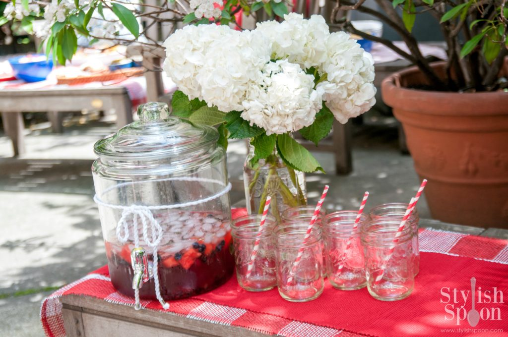 4th of july drinks - sangria white hydrangeas and mason jar glasses