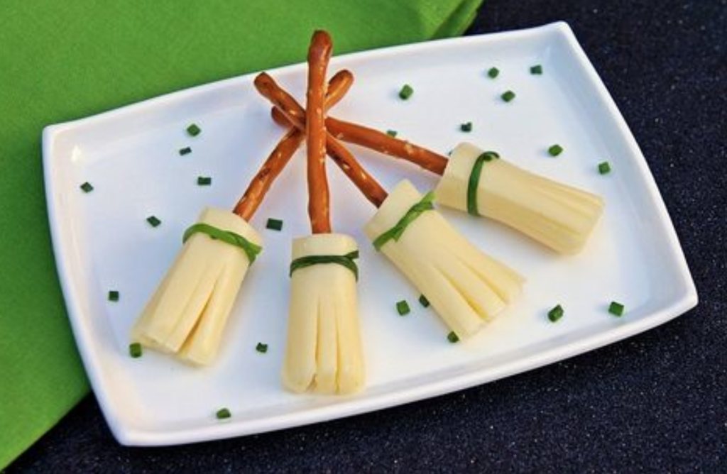 Healthy kids halloween snacks witch broomsticks cheese and pretzel