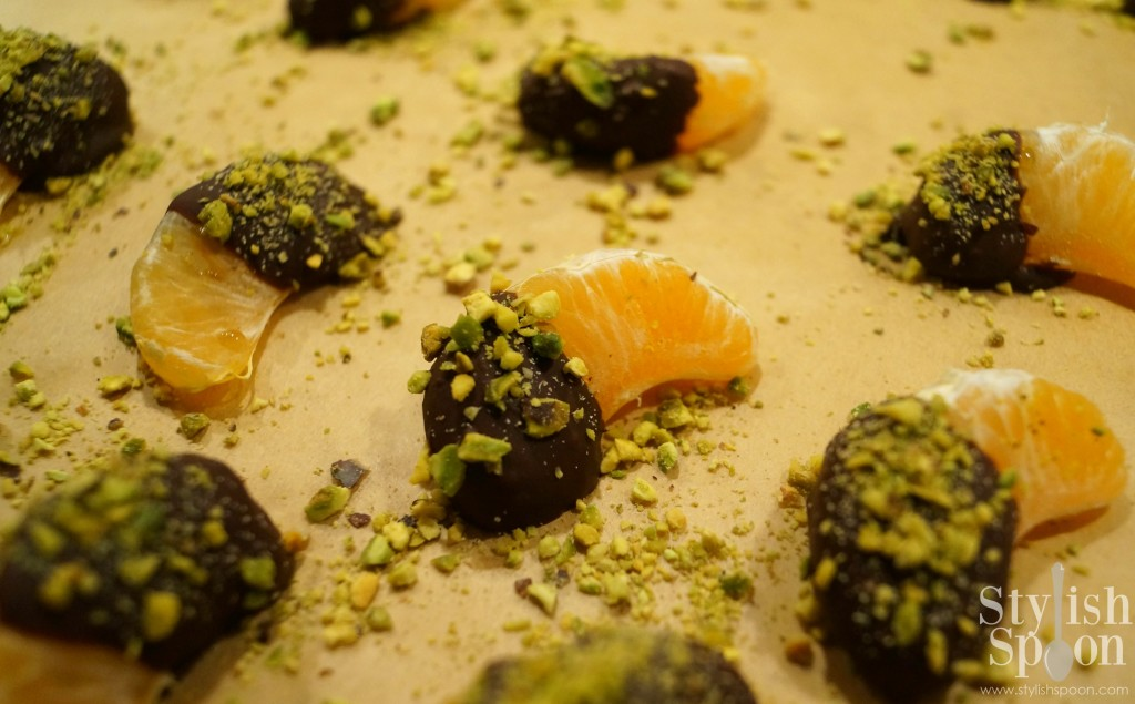 Chocolate covered clementines with pistachios