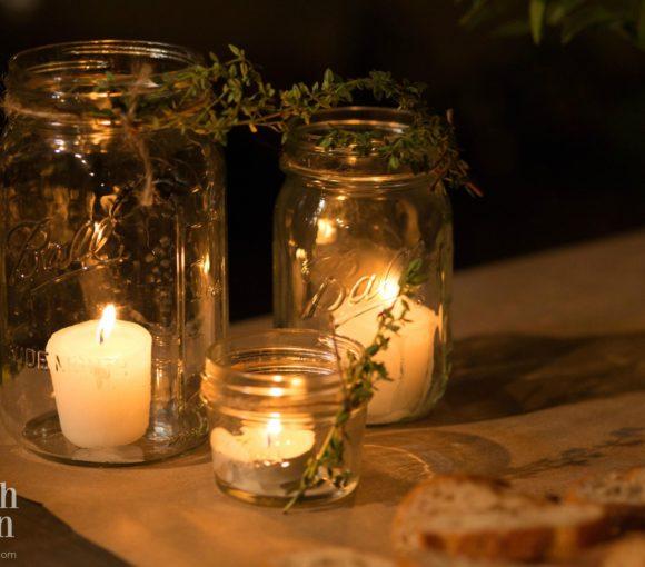 Mason Jars with tea lights and votives were used to create a warm glow