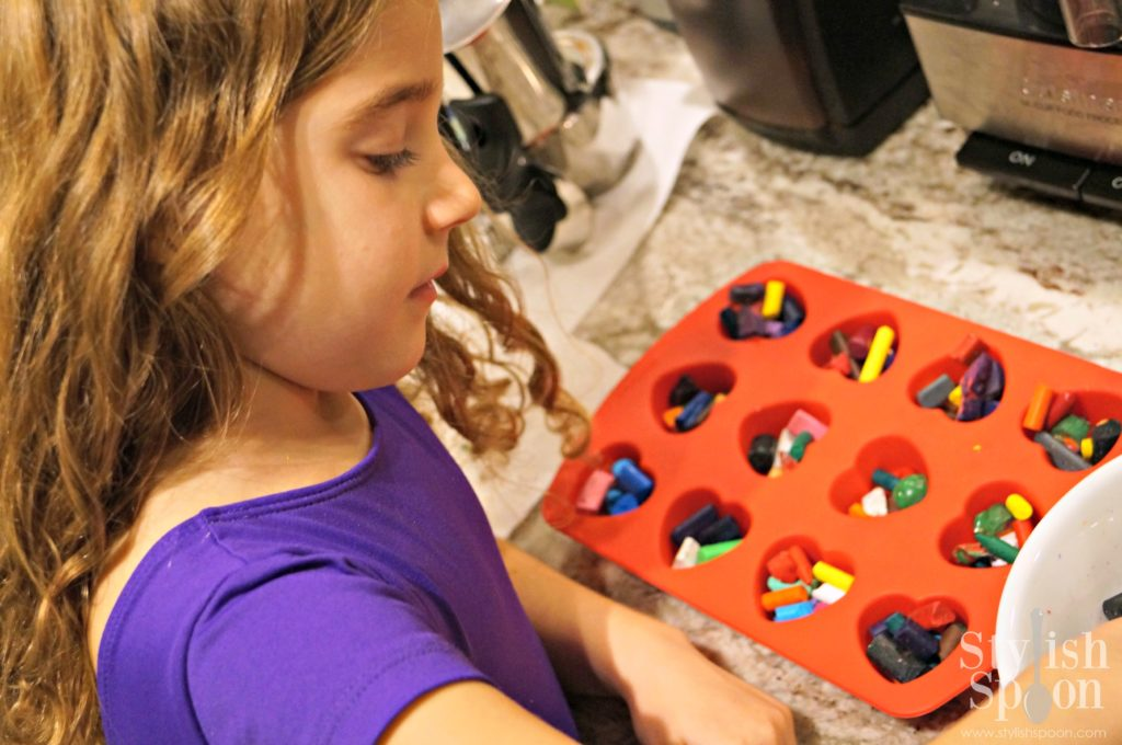 Filling the molds with the broken crayon pieces is something the kids can do themselves.